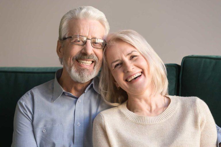 Older couple smiling after procedure
